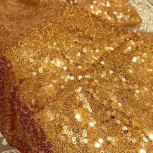 Six gold sequin table runners.